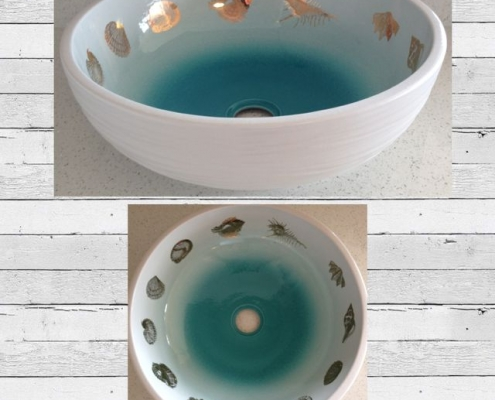 blue vessel sink with gold shells