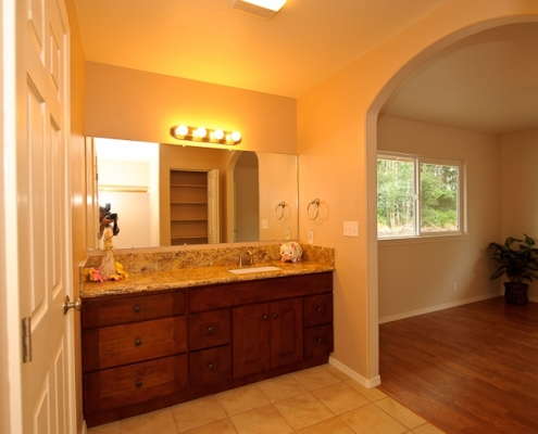 bathroom vanity, with granite countertop