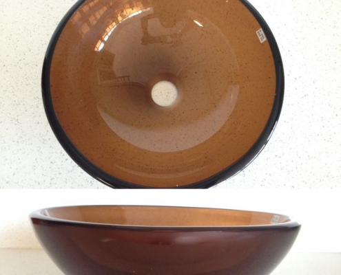 smokey-brown round vessel sink